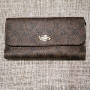 Signature coach tri-fold wallet